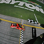 Jamie McMurray (1) followed by Dale Earnhardt Jr. (88) crosses the finish line to win the the NASCAR Daytona 500 auto race at Daytona International Speedway on Sunday, Feb. 14, 2010, in Dayt …