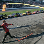 Crew members for driver Bobby Labonte throw a football on pit road during a red flag in the NASCAR Daytona 500 auto race at Daytona International Speedway in Daytona Beach, Fla., Sunday, Feb …