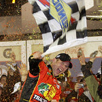 Jamie McMurray waves a checkered flag in victory lane after winning the NASCAR Daytona 500 auto race at Daytona International Speedway in Daytona Beach, Fla., Sunday, Feb. 14, 2010. (AP Phot …