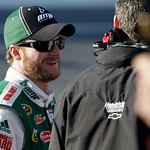 Dale Earnhardt Jr., left, talks with crew members during a delay because of a pothole in the track, in the Daytona 500 NASCAR auto race at Daytona International Speedway in Daytona Beach, Fl …