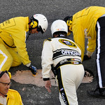 Workers repair a hole in the track during the second red-flag delay in the NASCAR Daytona 500 auto race at Daytona International Speedway in Daytona Beach, Fla., Sunday, Feb. 14, 2010. (AP P …