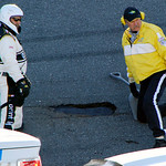 NASCAR and track officials examine a pothole in the track during the NASCAR Daytona 500 auto race at Daytona International Speedway in Daytona Beach, Fla., Sunday, Feb. 14, 2010. (AP Photo/R …