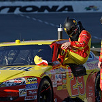 Kevin Harvick climbs into his car after at the end of a delay of more than an hour and a half because of a pothole in the pavement, in the Daytona 500 NASCAR auto race at Daytona Internation …