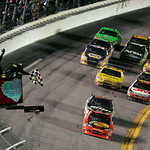 Jamie McMurray, front, takes the checkered flag ahead of Dale Earnhardt Jr. to win the NASCAR Daytona 500 auto race at Daytona International Speedway in Daytona Beach, Fla., Sunday, Feb. 14, …