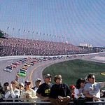 Fans watch the start of the Daytona 500 NASCAR auto race in front of a large video screen at Daytona International Speedway in Daytona Beach, Fla., Sunday, Feb. 14, 2010.(AP Photo/John Raoux …