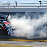 Sam Hornish Jr (77), Regan Smith (78) and Brad Keselowski (12) crash during the NASCAR Daytona 500 auto race at Daytona International Speedway in Daytona Beach, Fla., Sunday, Feb. 14, 2010. …