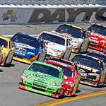 Drivers bring their cars through the tri-oval during the NASCAR Daytona 500 auto race at Daytona International Speedway in Daytona Beach, Fla., Sunday, Feb. 14, 2010. (AP Photo/Don Montague)
