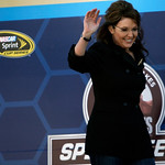 Former Alaska Gov. Sarah Palin waves to fans as she is introduced before the start of the Daytona 500 NASCAR auto race at Daytona International Speedway in Daytona Beach, Fla., Sunday, Feb.  …