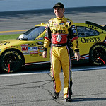 Clint Bowyer walks from his car during a red flag due to a hole in the track during the NASCAR Daytona 500 auto race at Daytona International Speedway in Daytona Beach, Fla., Sunday, Feb. 14 …
