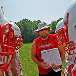 Elyria Coach Steve Hamilton gives a play to the offense Photo by Tom Mahl