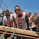 Elyria High players take water break on the first day of practice. Photo by Tom Mahl
