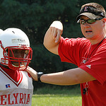 Elyria Defensive backs Coach Chad Heuser show where he want his defenders. Photo by Tom Mahl