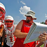 Elyria Coach Steve Hamilton gives marching orders to to the offense Photo by Tom Mahl