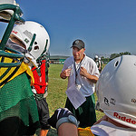 "Elyria Catholic Coach Ben Malbasa  gives marching orders to the ""Scout Team,"" as it prepares to run a play against the first team defense. Photo by Tom Mahl"