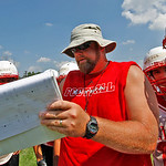 Elyria  Coach Steve Hamilton gives a play to to the offense Photo by Tom Mahl