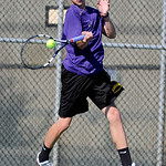 Avon freshman Nico Mostardi returns the ball toward Mayfield. KRISTIN BAUER | CHRONICLE