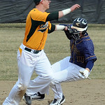 Amherst second baseman Zack Bires misses the tag on North Ridgeville's Nathan Colbert. STEVE MANHEIM/CHRONICLE