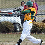 Amherst's Justin Mott hits a two-run RBI double. STEVE MANHEIM/CHRONICLE