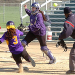 Avon's #3 Maddie Luca slides safely home as the ball gets away from Vermilion's catcher #12 Leigh Stainbrook.