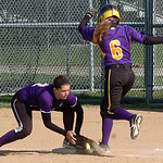Vermilion's #2 Carly Skettle tags Avon's #6 Rachael Poling  out as first.
