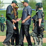 Amherst coach Matt Ronitano talks to pitcher Shane Derricotte on the mound. STEVE MANHEIM/CHRONICLE