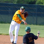 Amherst's Alex Walts is thrown out on a double play by St. Edward's Evan Kayser. STEVE MANHEIM/CHRONICLE