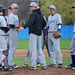 Avon freshman pitcher Logan Doenges meets with his team on the mound after walking three consecutive batters. KRISTIN BAUER | CHRONICLE