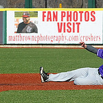 Avon's Ian Long beats the throw to steal second base past Elyria's Ben Haywood. STEVE MANHEIM/CHRONICLE