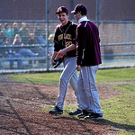 After a perfect three up, three down inning against Westlake High School, Avon Lake High School pitcher Logan DeLong (20) is congratulated by teammates and coaches on Tuesday afternoon, Apri …