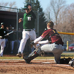 Avon Lake High School catcher Brad Hamilton (12) tags out Westlake High School Kent Axcell (8) at home plate on Tuesday afternoon, April 8 at Avon Lake High School.