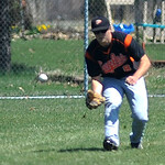 North Olmsted center fielder Brad Novak fields a ground ball during a game against Avon. KRISTIN BAUER | CHRONICLE