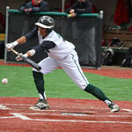 Elyria Catholic's Angelo Cruz puts the bunt down to advance two runners on base. CHRISTY LEGEZA/CHRONICLE