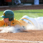 Amherst's Alex Walts slides safely into home. STEVE MANHEIM/CHRONICLE