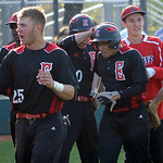 Elyria players congratulate Brendon Koziura after he scored. STEVE MANHEIM/CHRONICLE