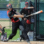 Elyria's Zack Rosenkoetter hits a two-run RBI double in the second inning. STEVE MANHEIM/CHRONICLE