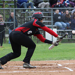 Elyria's Brendon Koziura lays down a bunt. CHRISTY LEGEZA/CHRONICLE