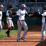 Lorain High celebrates a successful inning against Euclid at The Pipeyard on May 6. KRISTIN BAUER | CHRONICLE