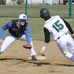 Midview's Cody Callaway gets ready to tag out Elyria Catholic's Lukas Redmond as Redmond tries to steal second during Wednesday's West Shore Conference game. STEVE MANHEIM/CHRONICLE
