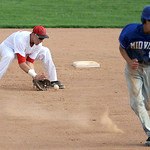 Elyria's Jacob Csizmadia fields a ground ball as Midview's Zach Nilges sprints to third. KRISTIN BAUER | CHRONICLE