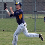 North Ridgeville's Mike Martin makes a running catch in the outfield. STEVE MANHEIM/CHRONICLE
