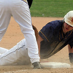 North Ridgeville's Nolan Freeman returns to first base safely on a pick-off attempt. STEVE MANHEIM/CHRONICLE