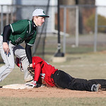EC's Colt Schuler tags out Elyria's Jaeger Shaffstall  at 3rd base at Elyria High. photo by Ray Riedel