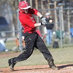 Elyria's #25 pops a foul ball before getting a base hit and batting in a run at Elyria High. photo by Ray Riedel