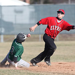EC's Angelo Cruz is safe 2nd as Elyria's Dakota Justin reaches for the ball at Elyria High. photo by Ray Riedel