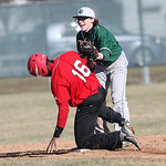 EC's James Rickard tags out Elyria's Marques Inman at 2nd base at Elyria High. photo by Ray Riedel