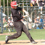 Elyria's #25 Jacob Csizmadia hits.