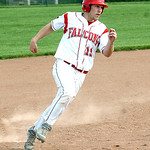 Firelands' #11 Brett Helton runs from third, heading home to score.
