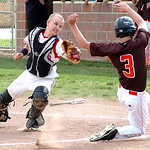 Firelands' catcher #10 Tristan Clark lunges to tag  Buckeye's #3 Nick Duliba as he slides into home plate. Nick was called out at the plate.