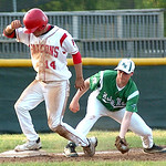 Firelands' #14 Joe San Felippo makes it to base before Holy Name's #21 Alex Tober can make the tag.