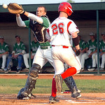 Firelands' #26 Garrett McKinney heads for home safely as Holy Name's catcher #10 Matteo Beechuk waits for the ball.